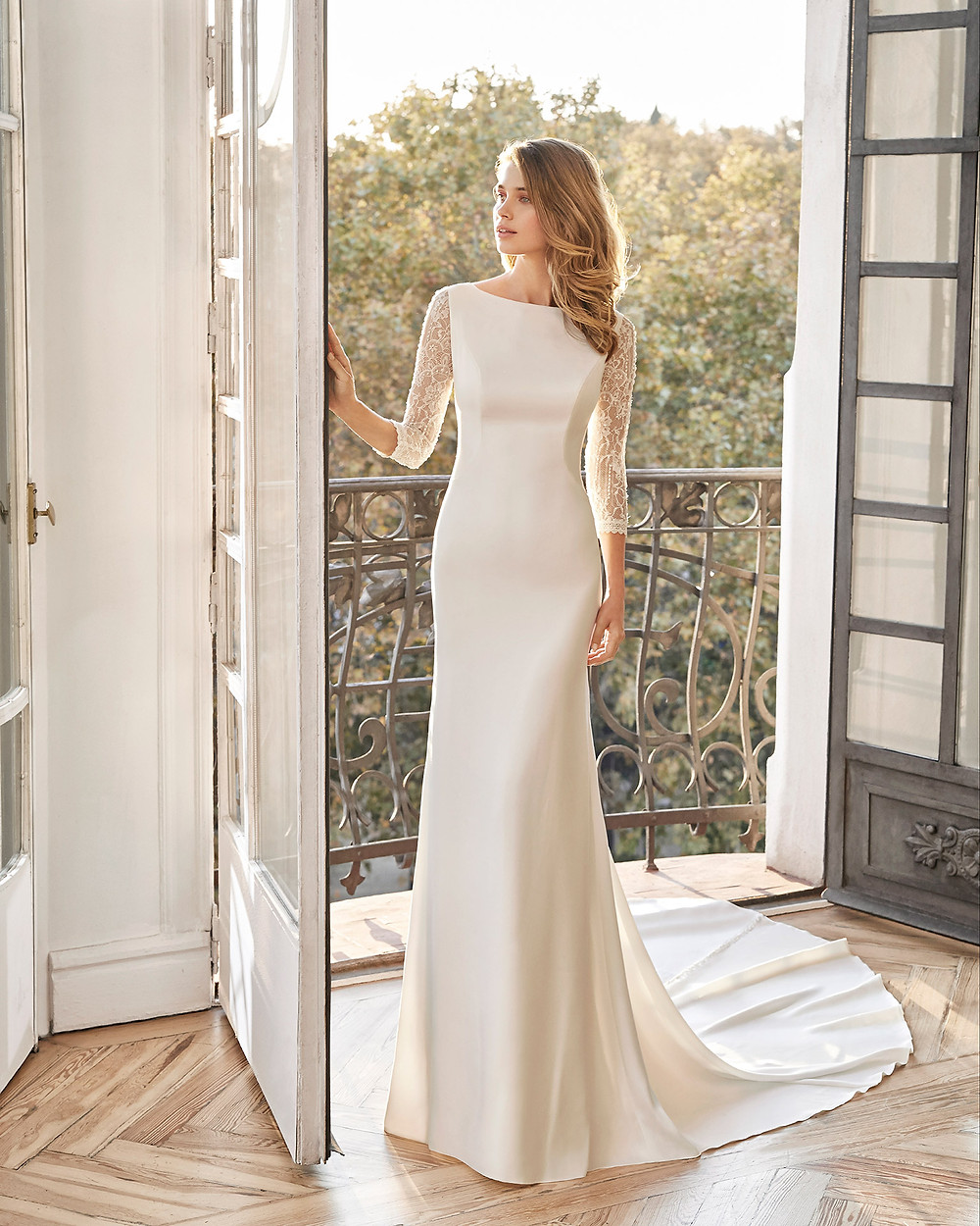 An Aire Barcelona 2020 silk mermaid fit and flare wedding dress with long lace illusion sleeves