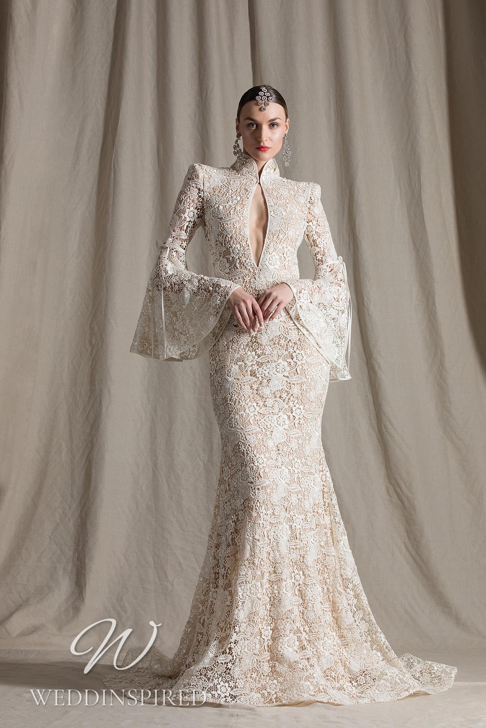 A Naeem Khan 2022 lace mermaid wedding dress with long sleeves