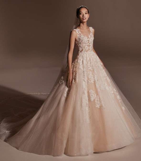 A Pronovias blush lace and tulle ball gown wedding dress