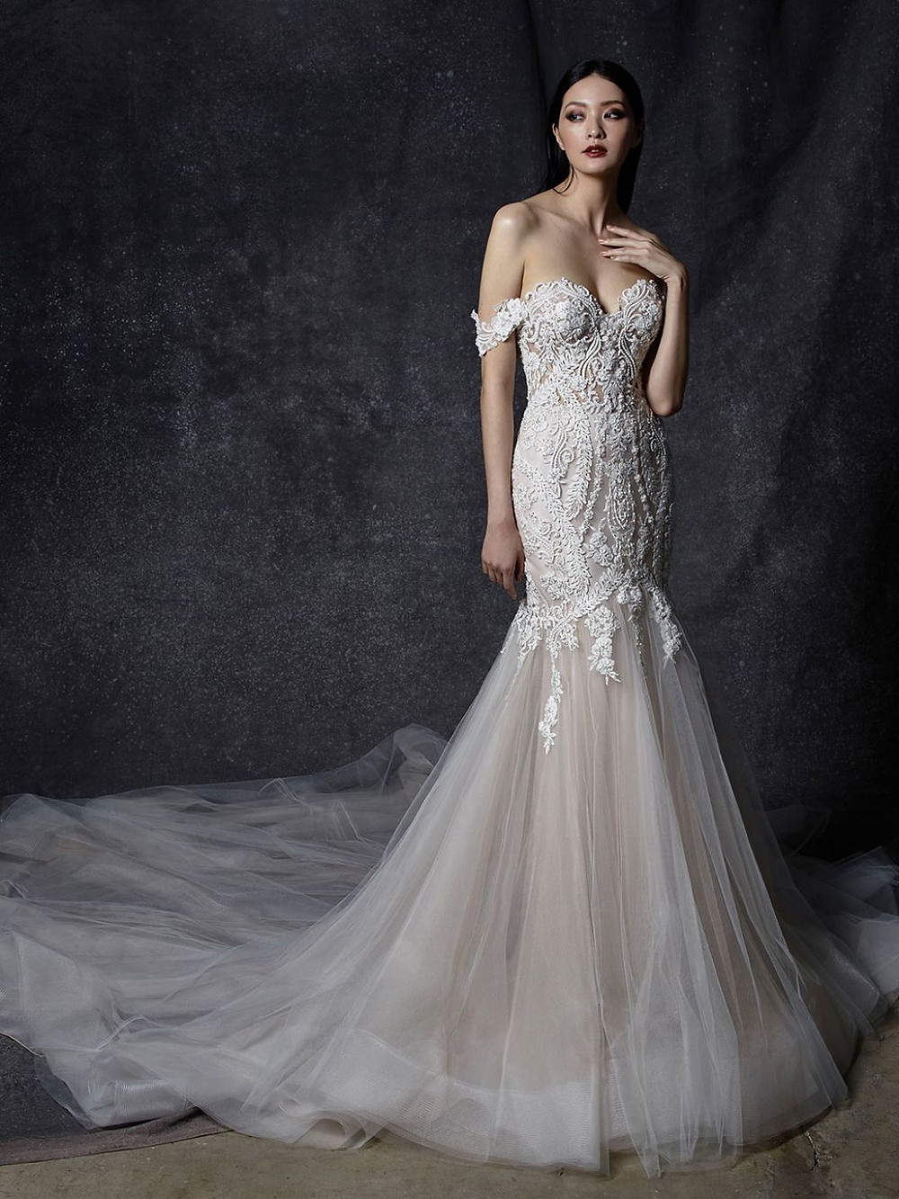 An Enzoani off the shoulder lace wedding dress with a tulle skirt and a sweetheart neckline