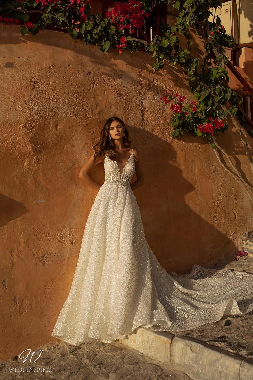 A Ricca Sposa sparkly lace A-line wedding dress with a deep v neckline and straps