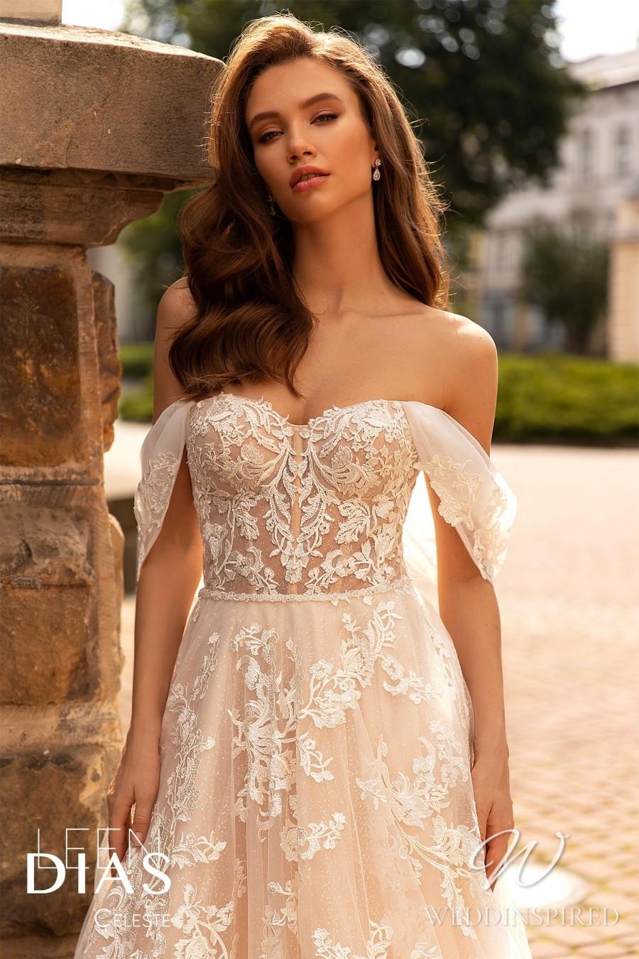 A Leen Dias 2021 blush lace off the shoulder A-line wedding dress