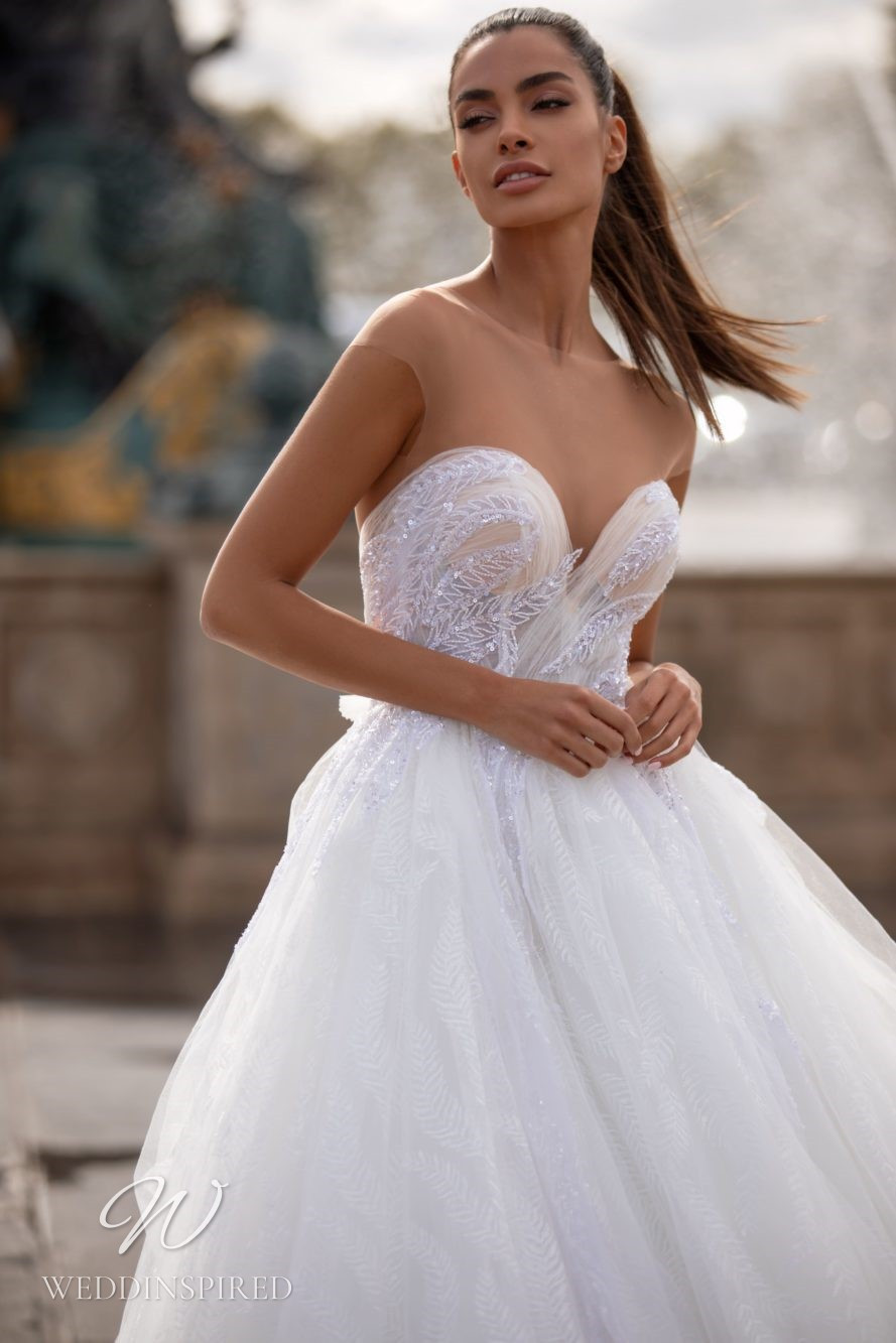 A Milla Nova tulle ball gown wedding dress with a sweetheart neckline and an illusion top