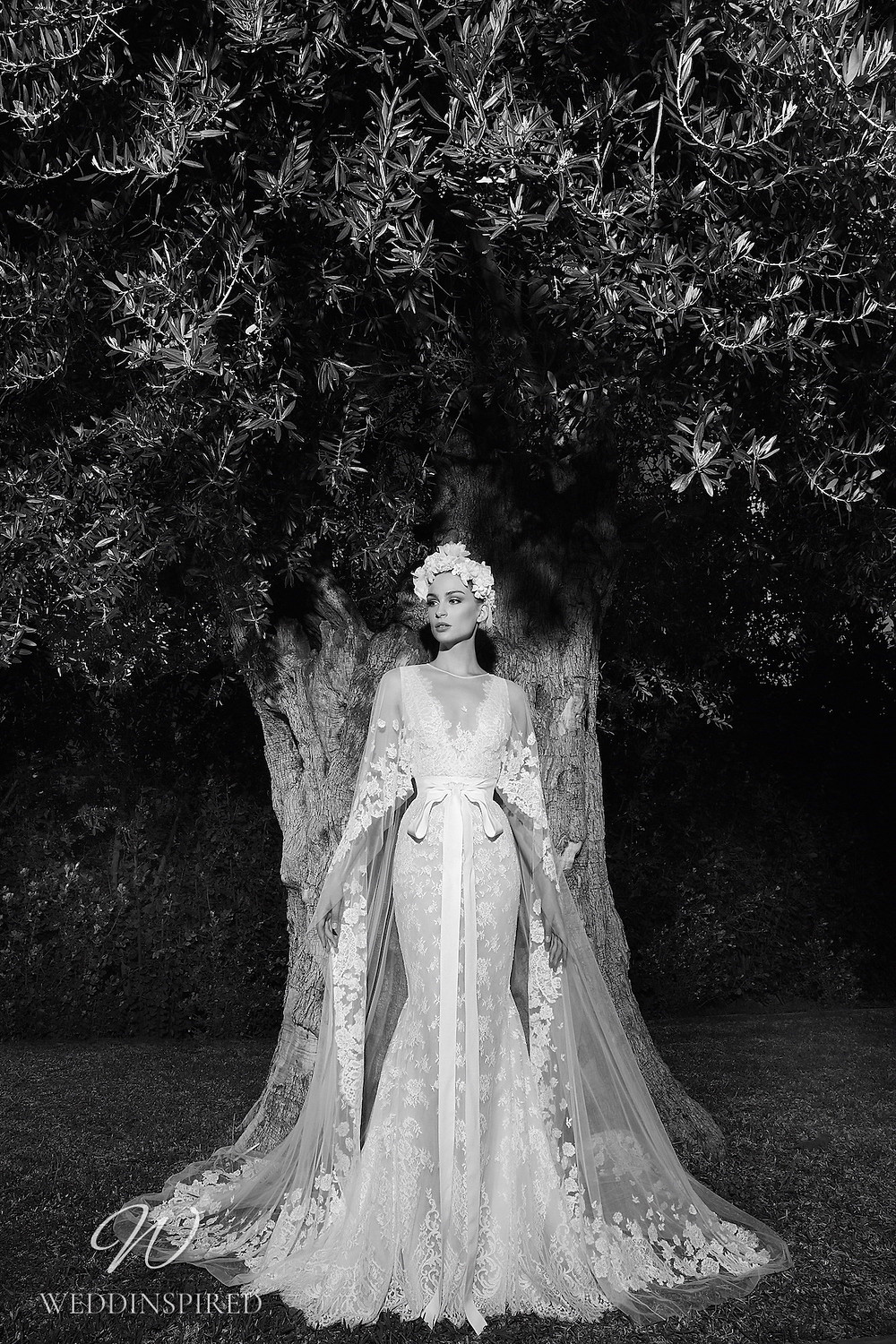 A Zuhair Murad Spring 2022 lace mermaid wedding dress with a v neck