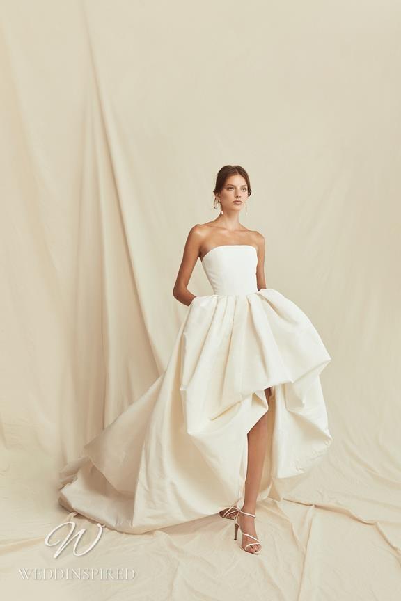 A Oscar de la Renta 2021 simple strapless ball gown wedding dress