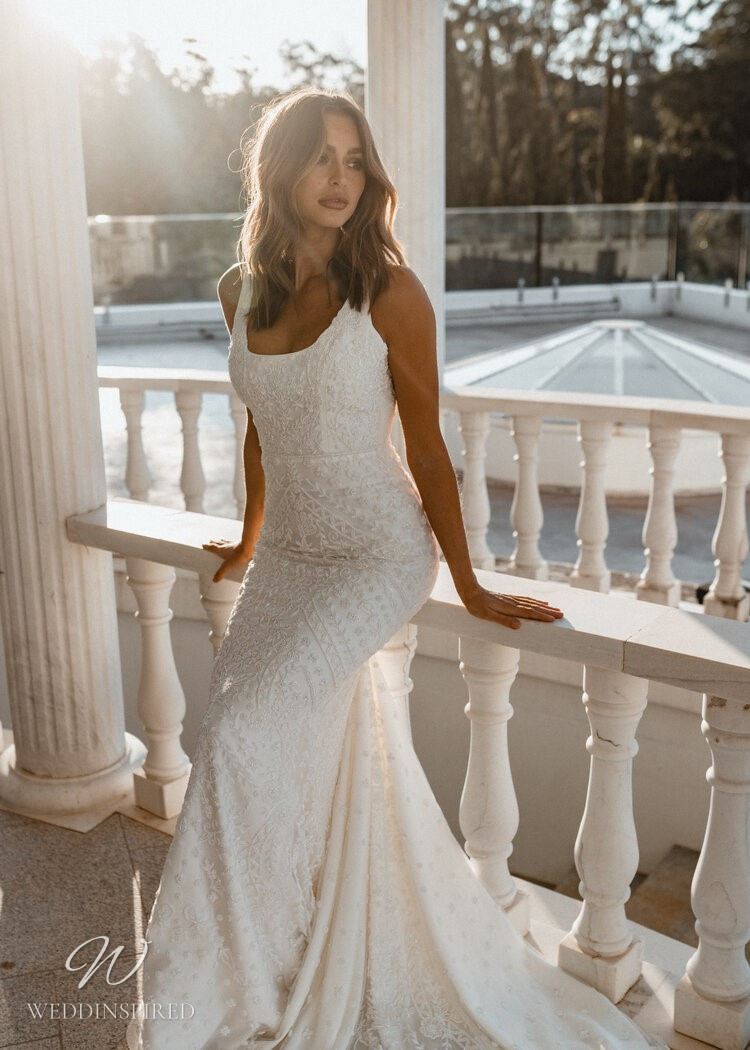 An Anna Campbell 2020 fitted white wedding dress with a square neckline and a long train