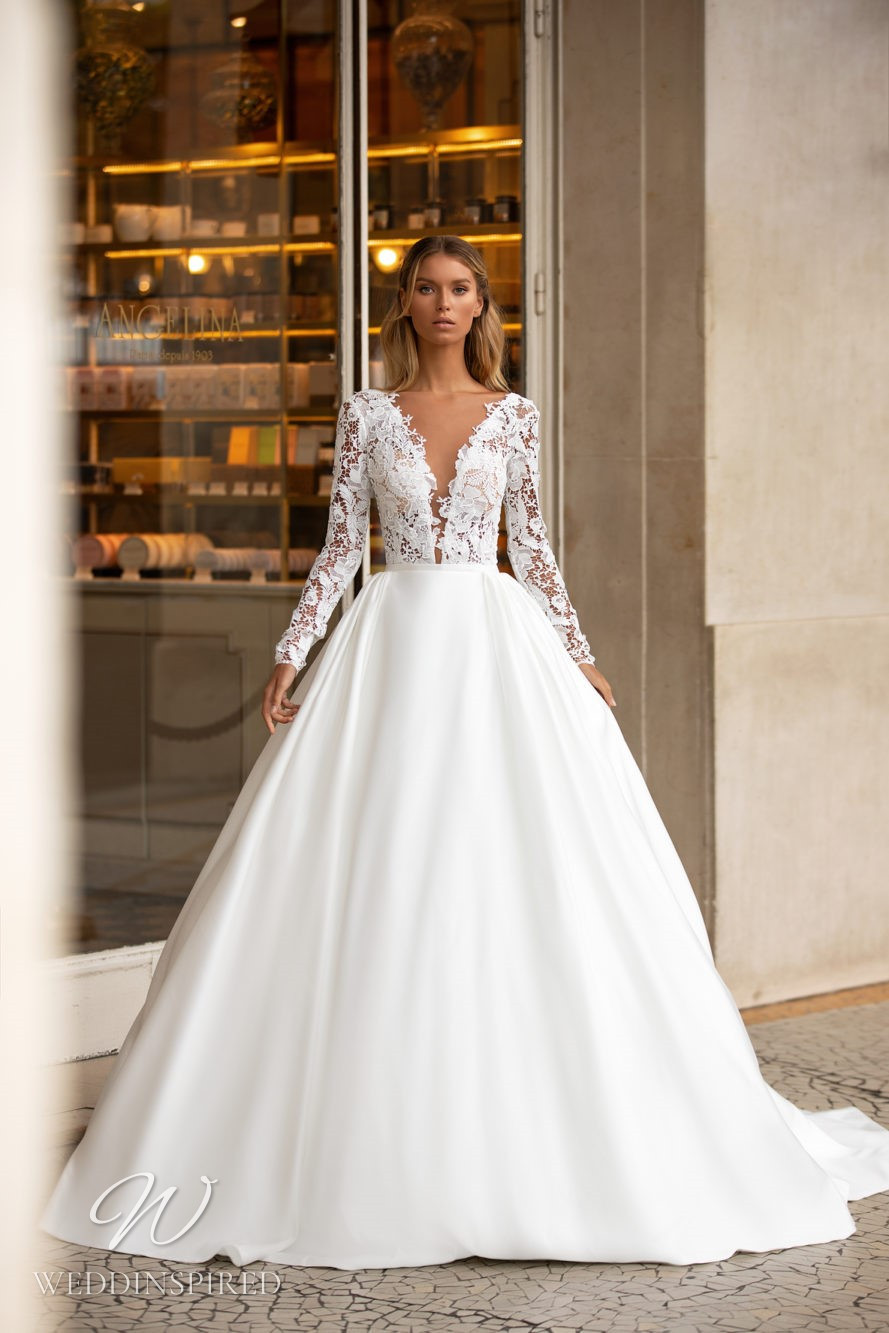 A Milla Nova princess ball gown wedding dress with lace and long sleeves