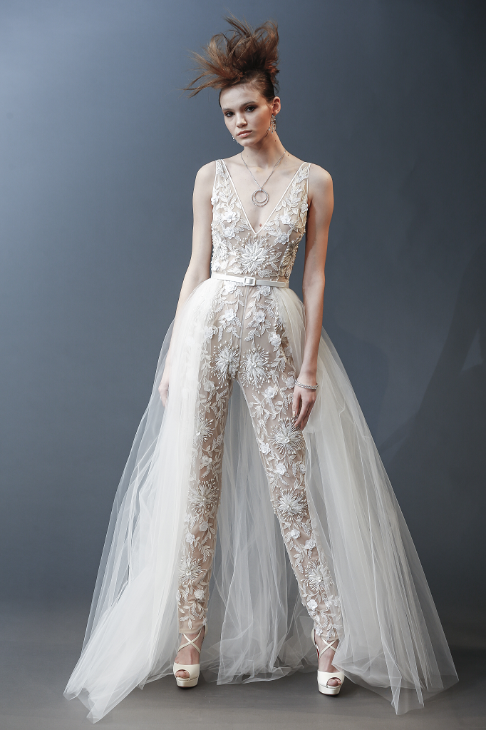 A Naeem Khan lace wedding jumpsuit or pantsuit with a tulle detachable skirt