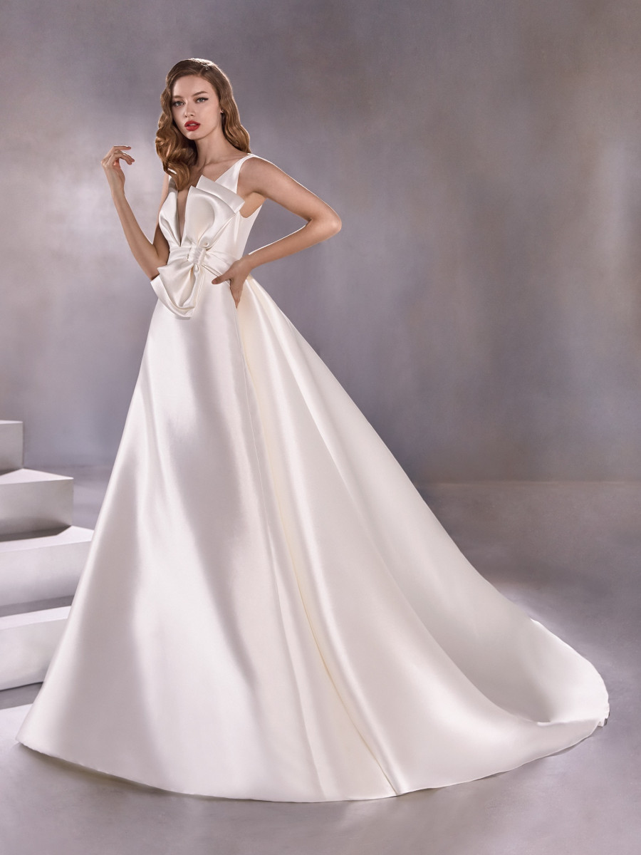 A Pronovias simple silk ball gown wedding dress with a bow