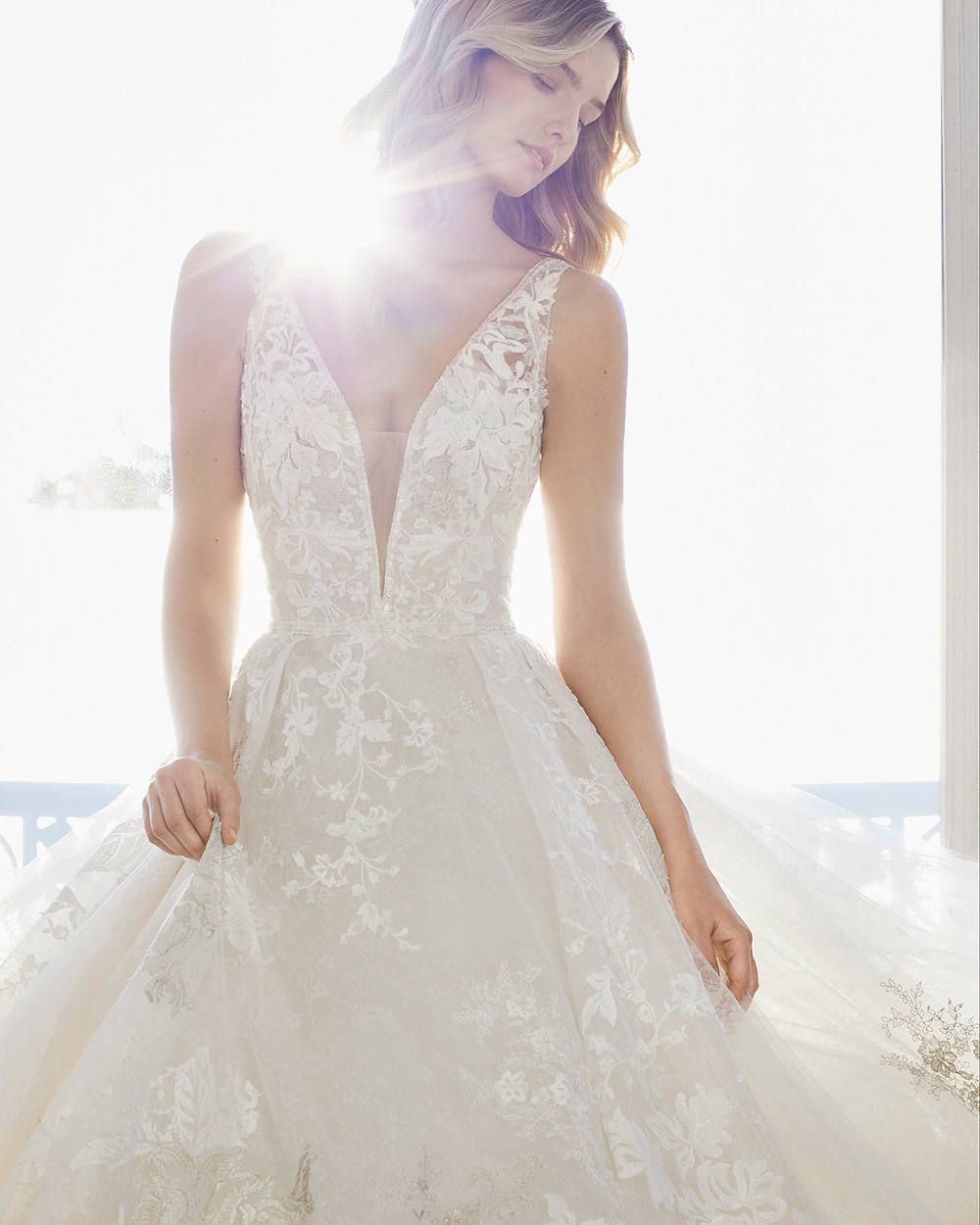 An Aire Barcelona 2020 ivory lace and tulle ball gown wedding dress with a v neckline and straps