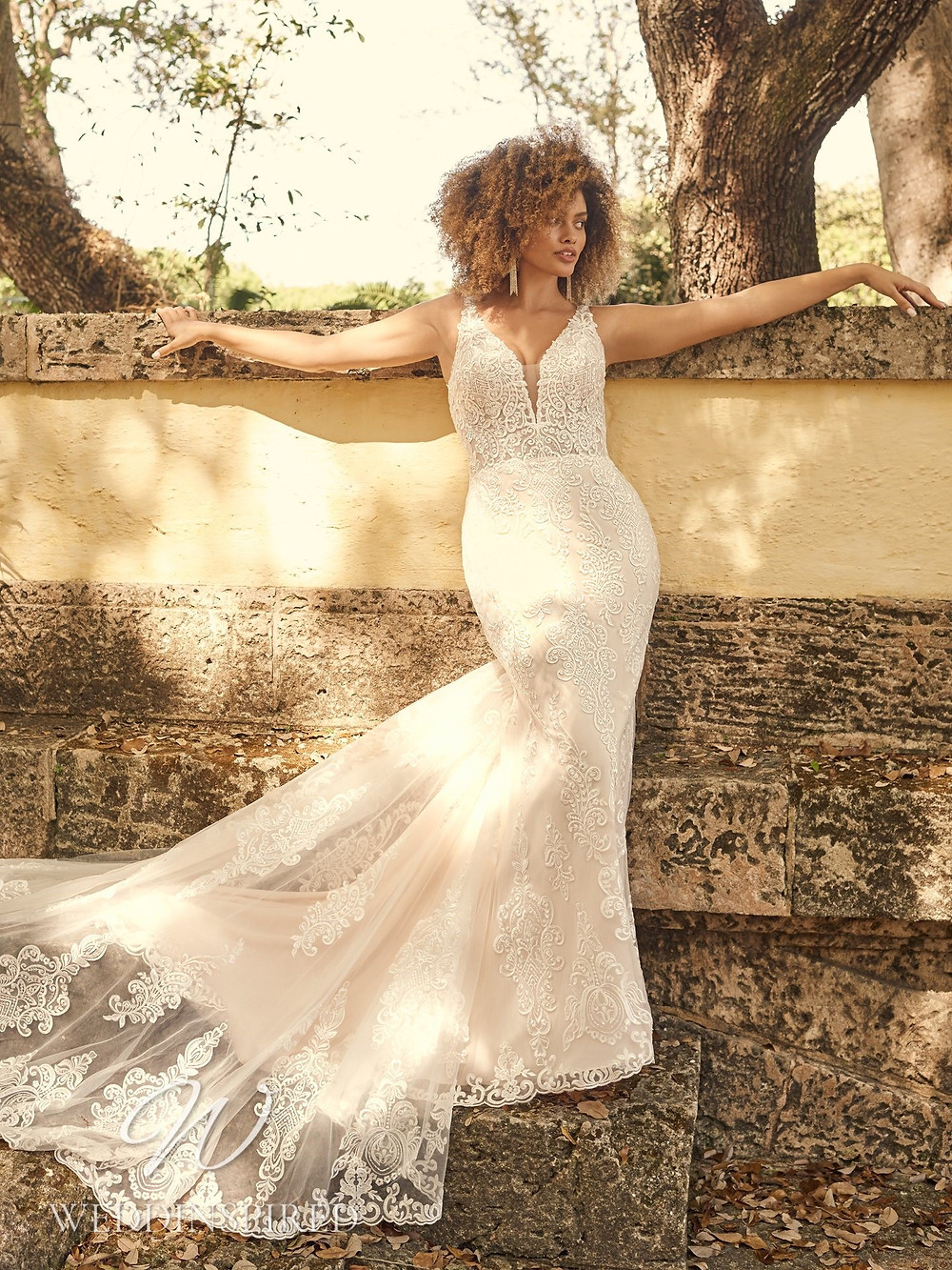 A Maggie Sottero 2021 lace mermaid wedding dress
