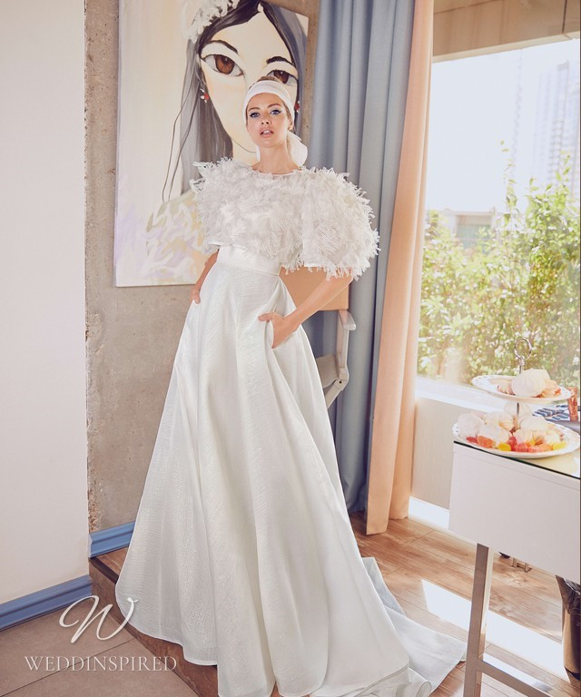 A Blammo-Biamo 2021 simple A-line wedding dress with pockets and a tulle jacket