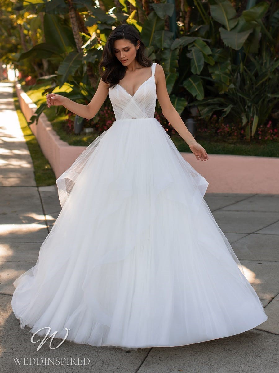 A Pronovias 2021 simple ball gown wedding dress with straps and a v neck