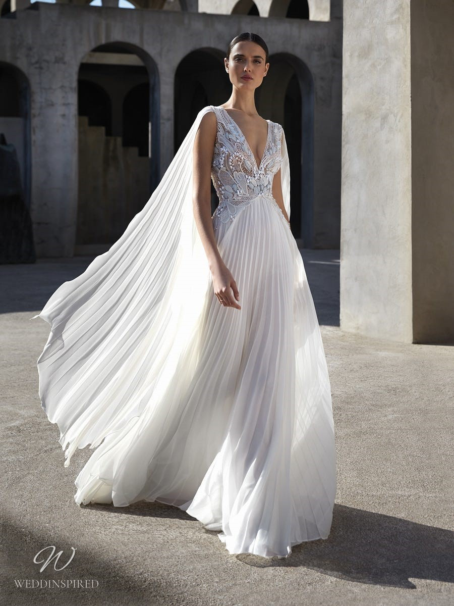 An Atelier Pronovias pleated chiffon A-line wedding dress with a low v neckline and beading