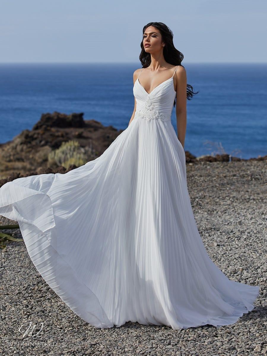 A Pronovias 2021 simple strappy pleated A-line wedding dress with a v neckline