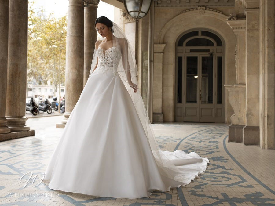 A Pronovias Privée 2021 strapless satin and lace ball gown wedding dress with a sweetheart neckline