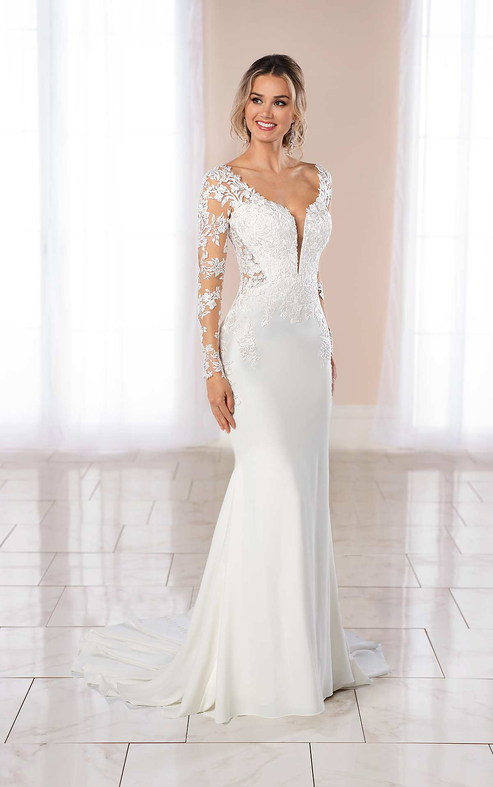A Stella York 2020 lace and silk mermaid fit and flare wedding dress with long illusion sleeves