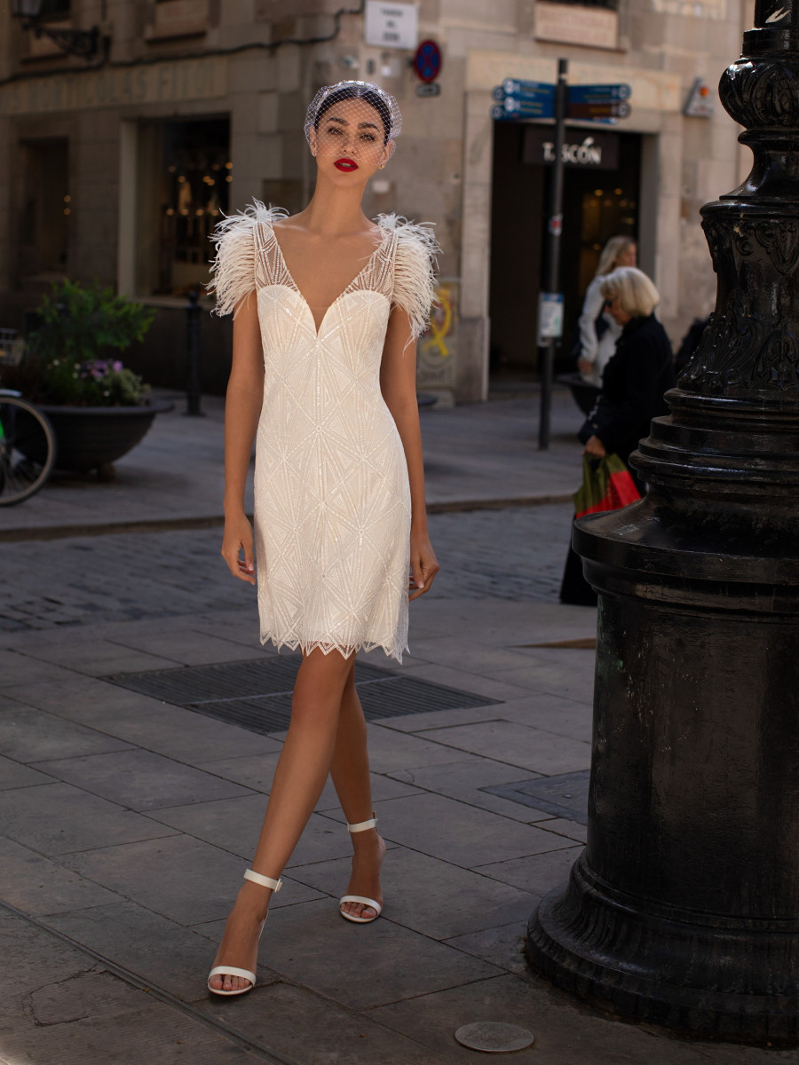 A Pronovias mesh, beading and feathers short wedding dress