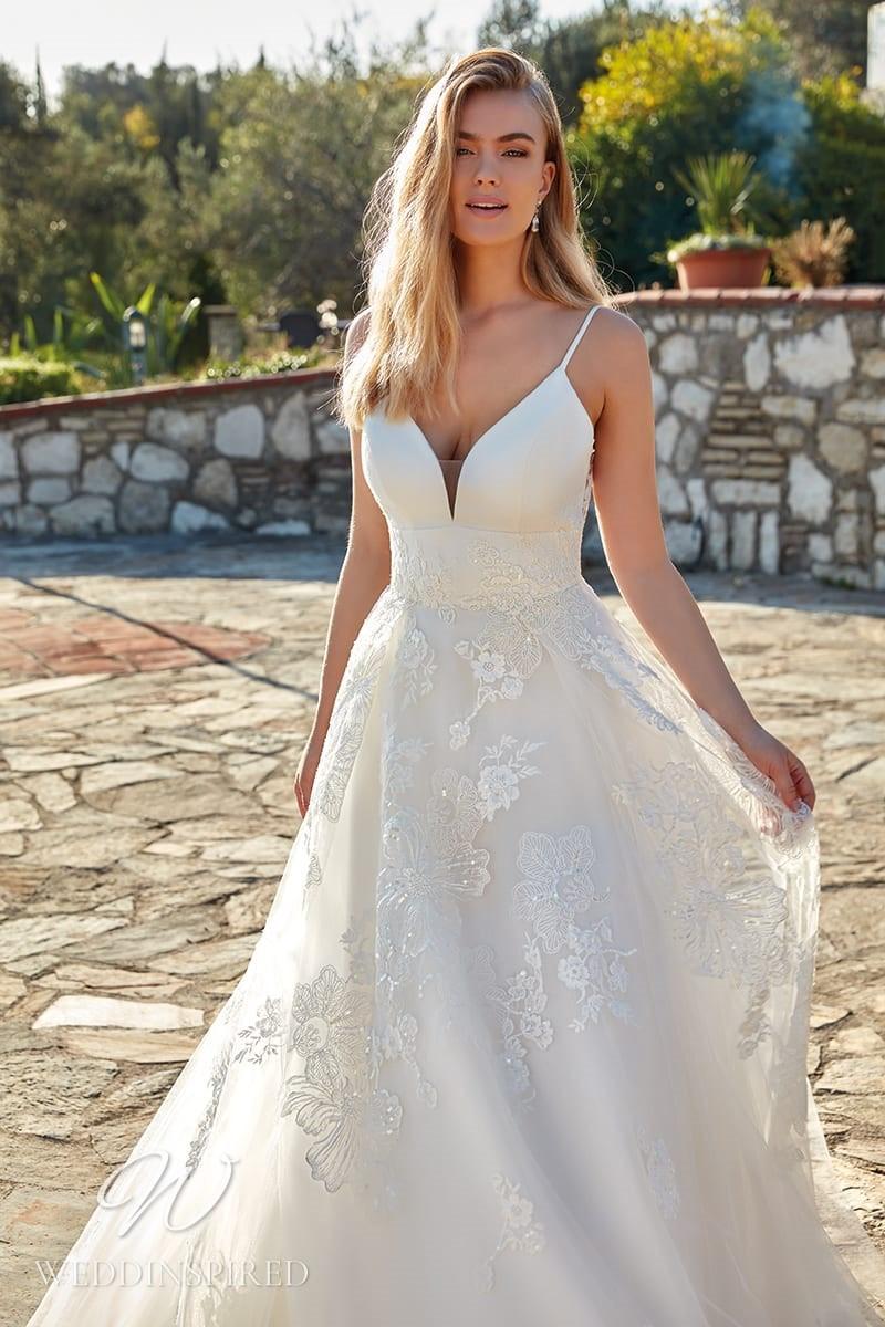 An Eddy K 2022 satin and tulle A-line wedding dress