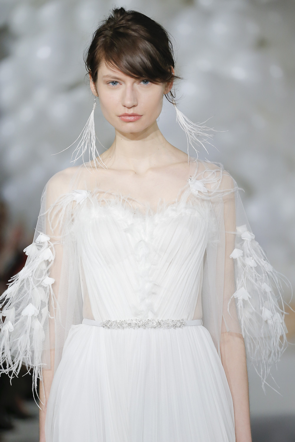 A Mira Zwillinger chiffon and feathers A-line wedding dress