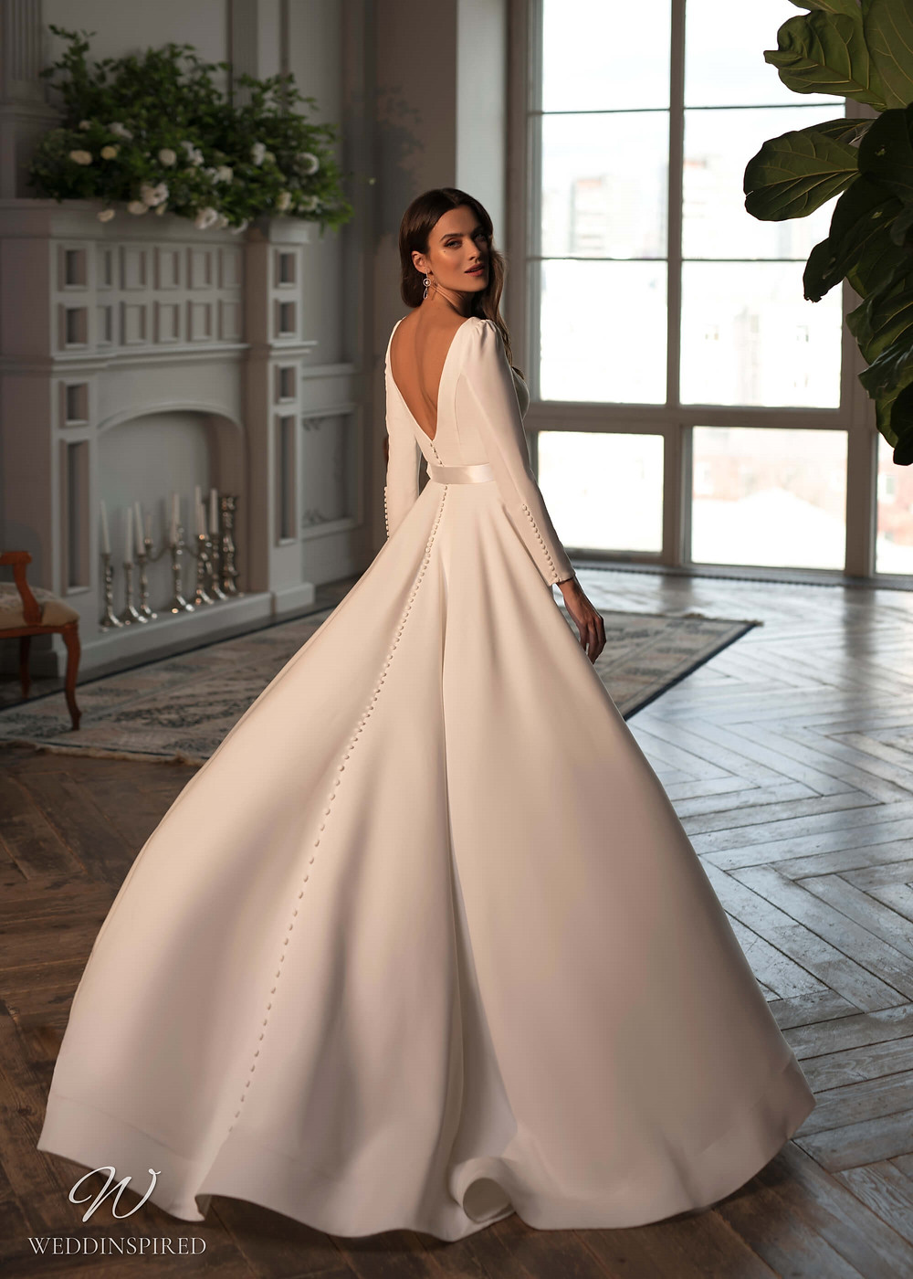 A Naviblue Bridal 2021 crepe simple ball gown wedding dress with long sleeves, a low back and buttons