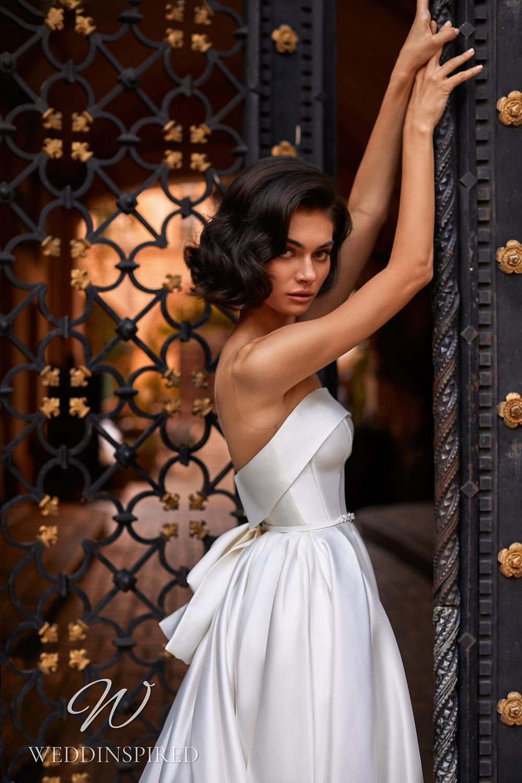 A Daria Karlozi 2021 strapless satin A-line wedding dress