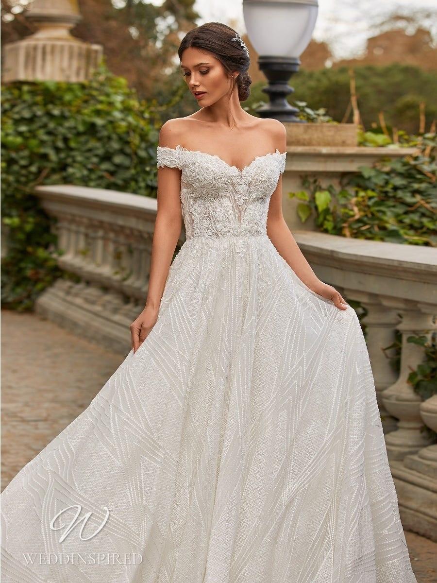 A Pronovias Privée 2021 off the shoulder lace A-line wedding dress