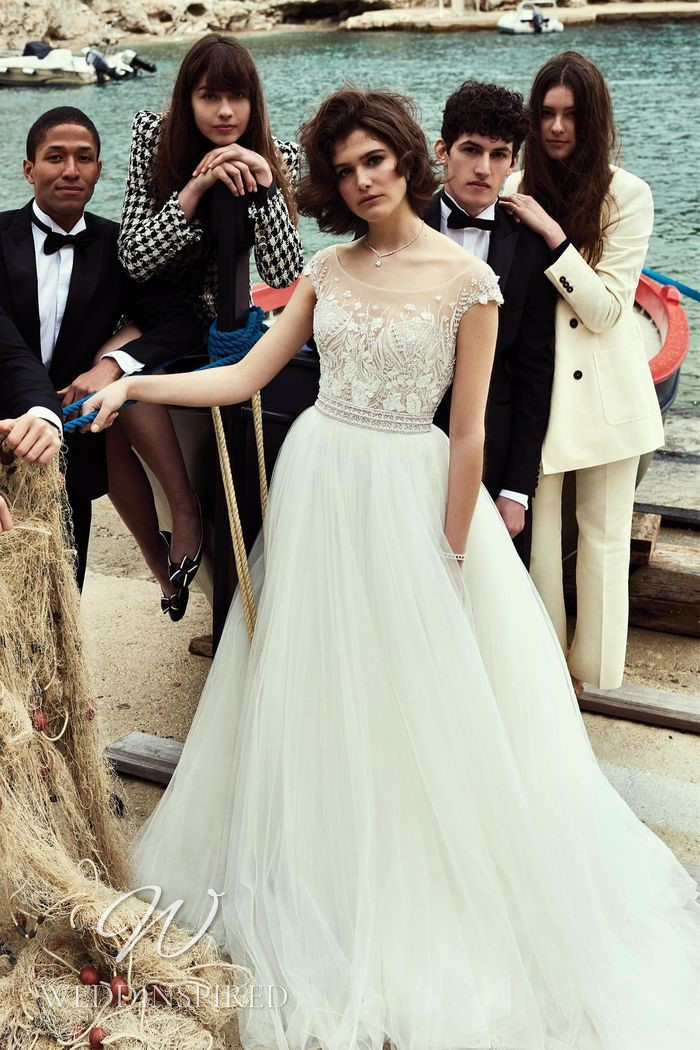 A Justin Alexander 2021 tulle A-line wedding dress with cap sleeves