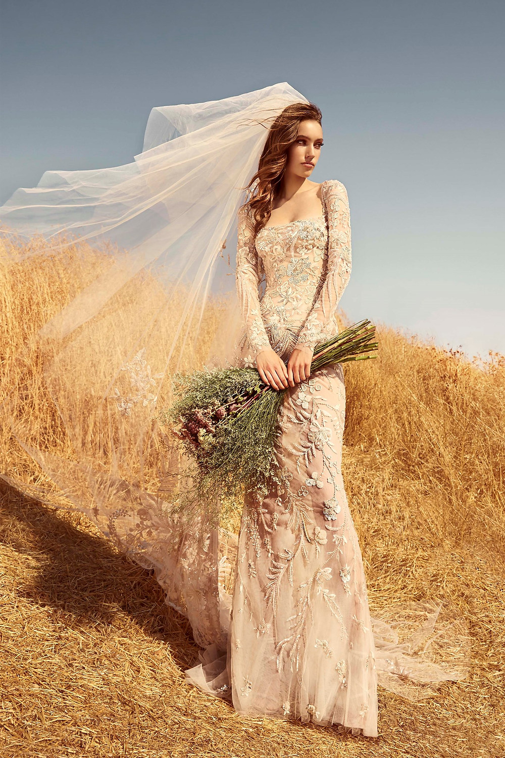 A Zuhair Murad blush mermaid wedding dress, with tulle, long sleeves and embroidery