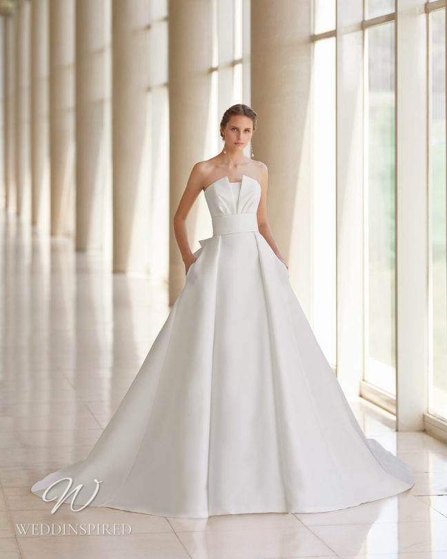 An Aire Barcelona 2021 strapless satin princess ball gown wedding dress with pockets
