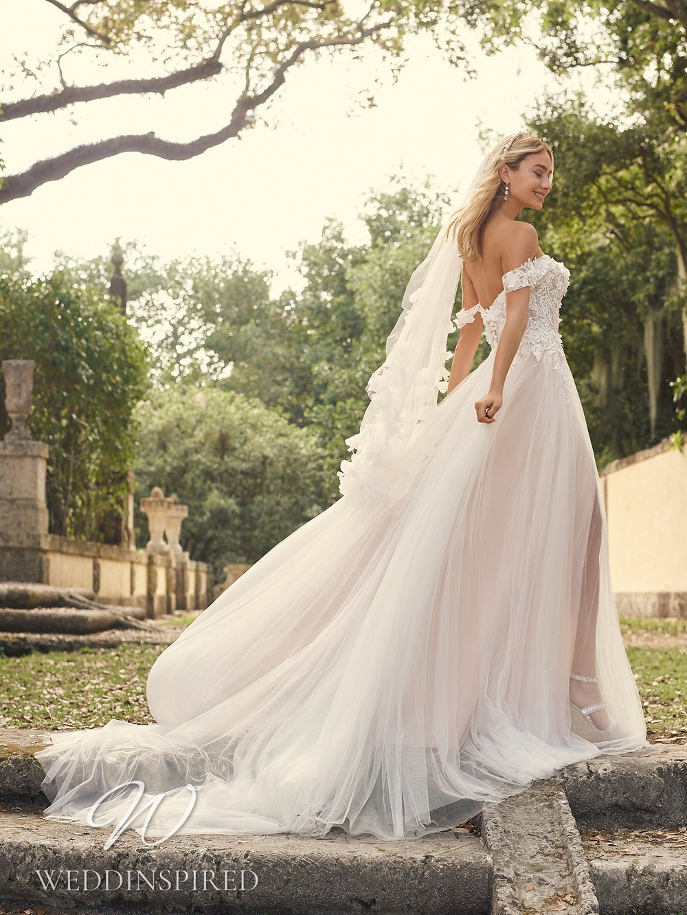 A Maggie Sottero 2021 off the shoulder lace and tulle A-line wedding dress