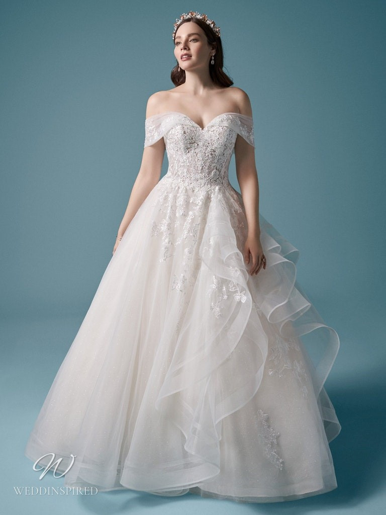 A Maggie Sottero 2021 off the shoulder lace and tulle ball gown wedding dress