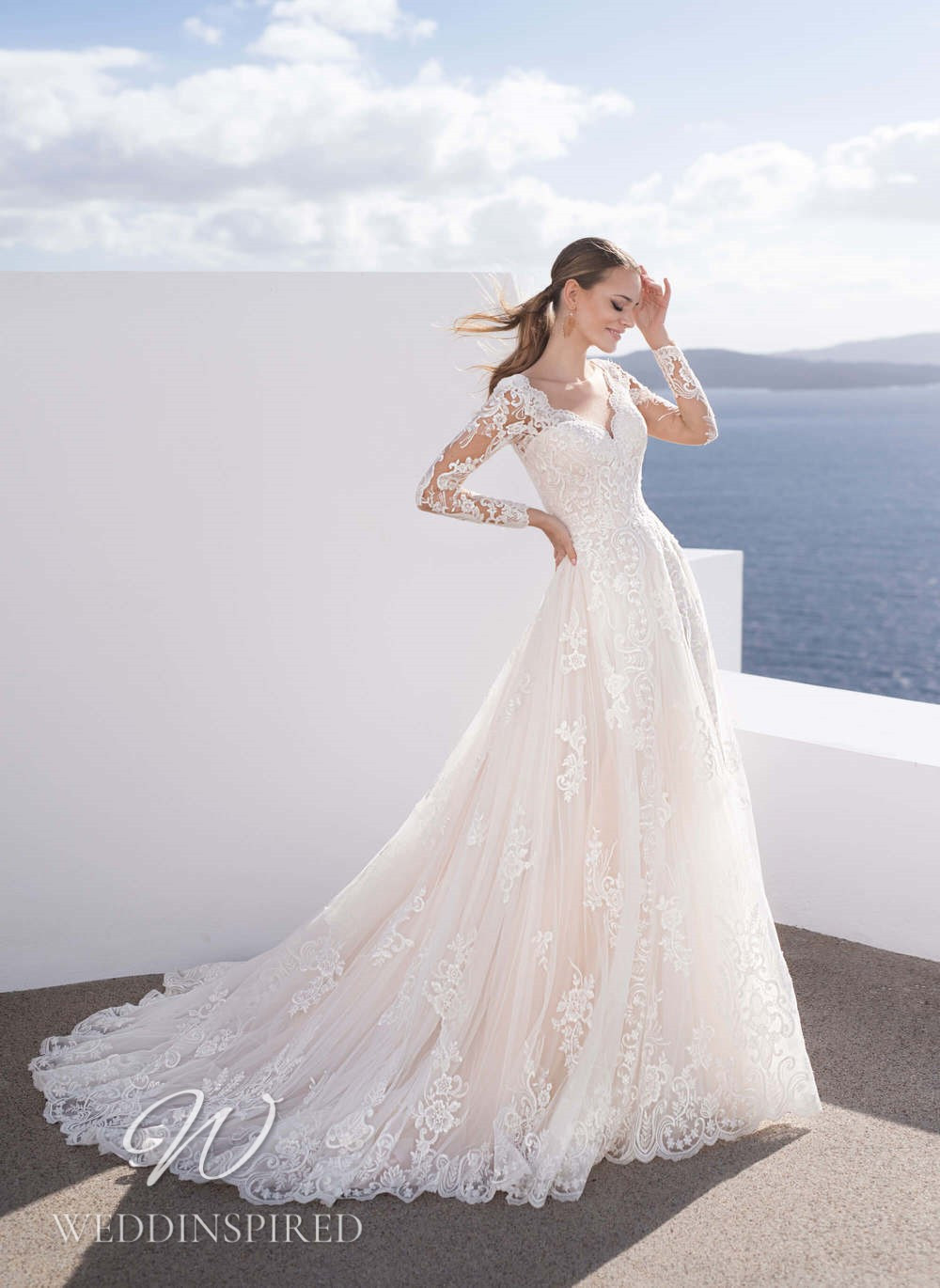 A Blunny 2021 lace A-line wedding dress with long sleeves