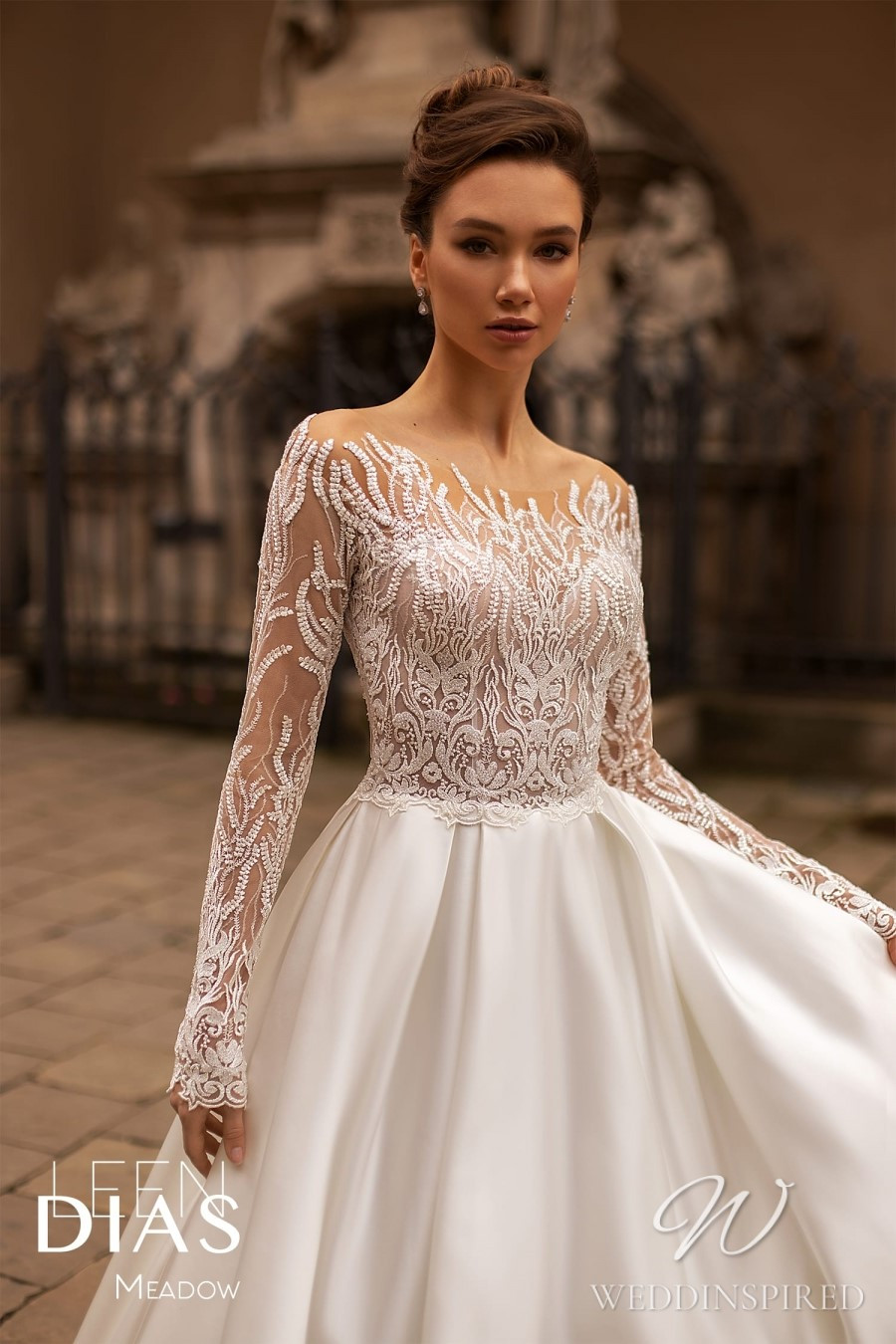 A Leen Dias 2021 off the shoulder lace and satin A-line wedding dress