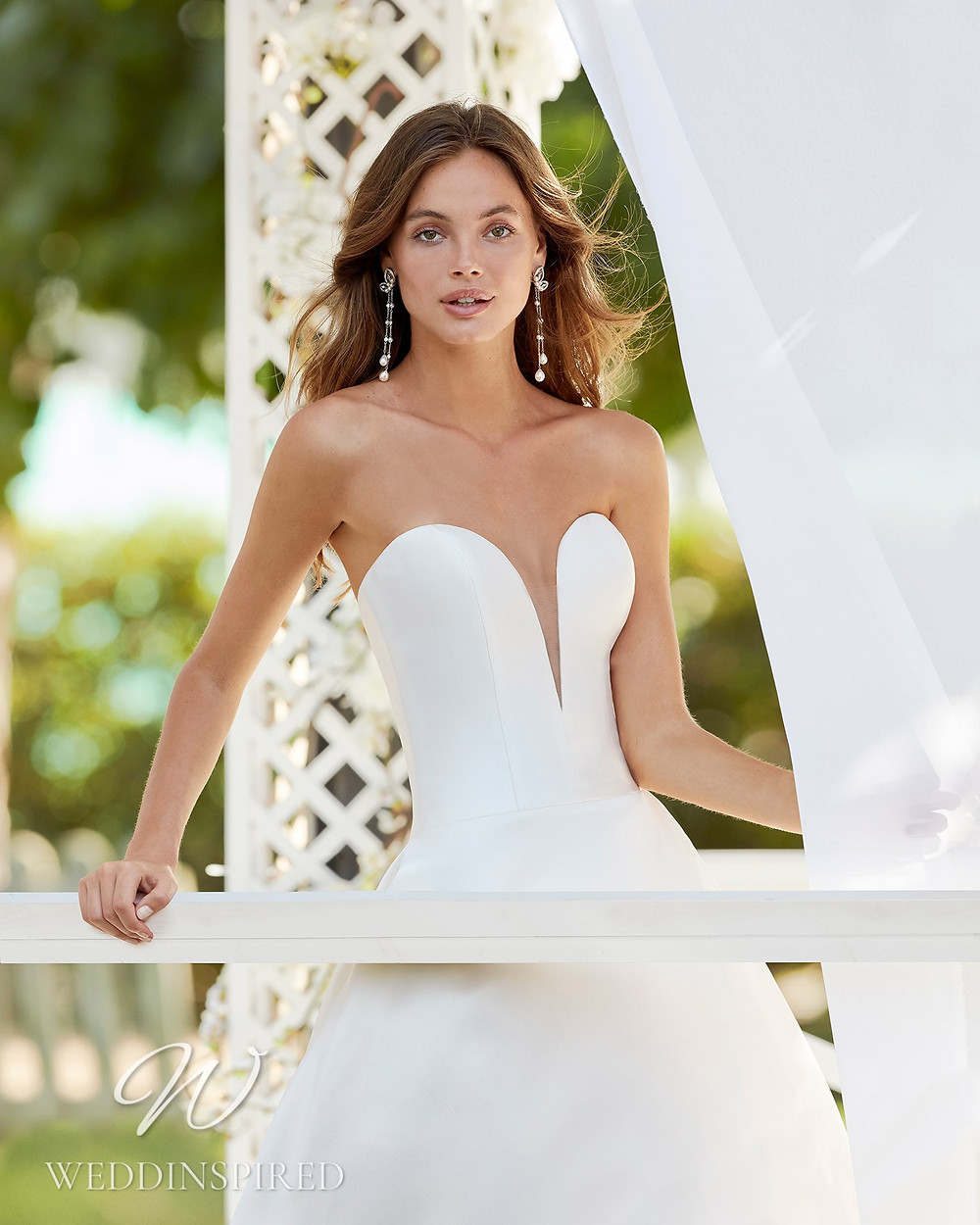 An Aire Barcelona 2021 simple satin and tulle strapless A-line wedding dress