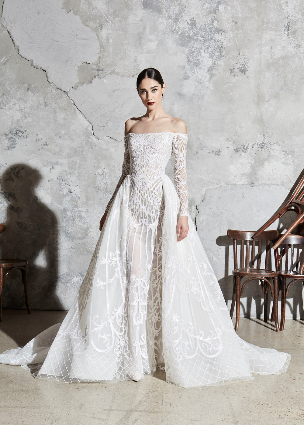 An off the shoulder, A-line wedding dress, with detachable skirt and long sleeves