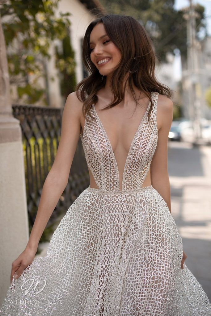 An Eden Aharon 2020 sparkly crochet A-line wedding dress with low v neckline and straps
