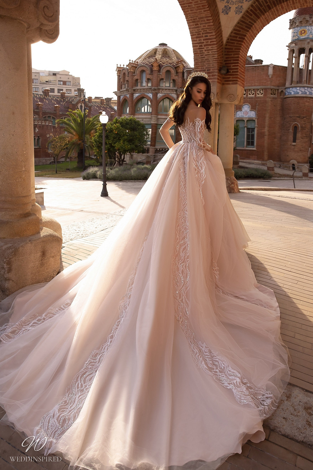 A Maks Mariano blush sparkle tulle princess ball gown wedding dress with illusion top
