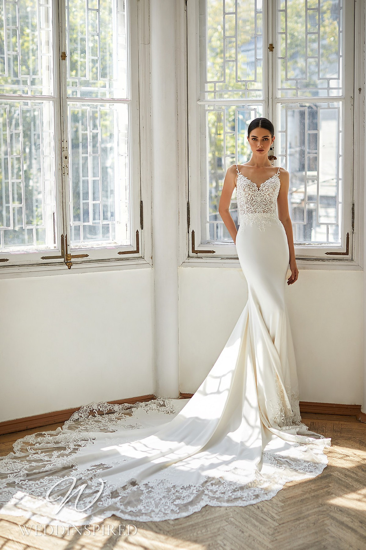 A Daria Karlozi 2021 lace and satin mermaid wedding dress
