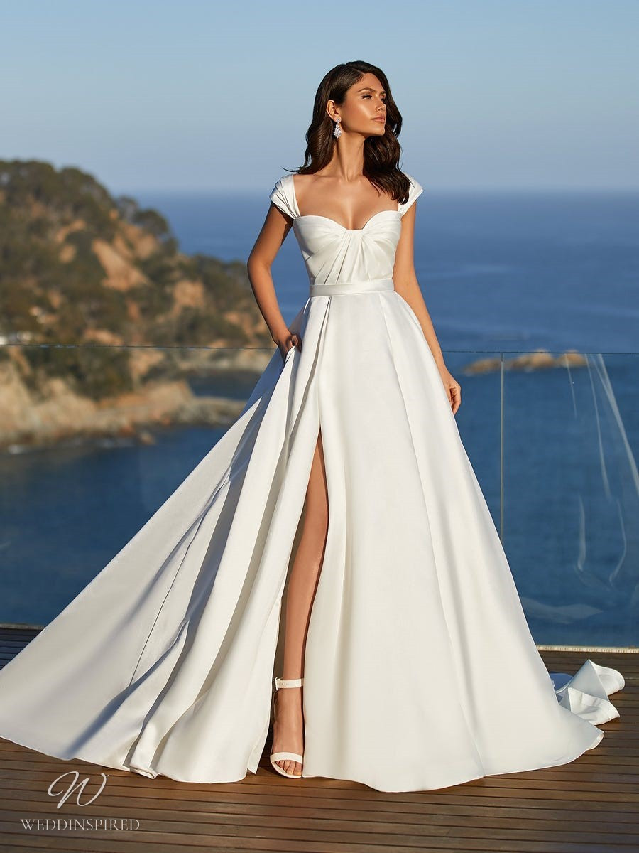 A Pronovias 2021 simple silk ball gown wedding dress with cap sleeves and a slit