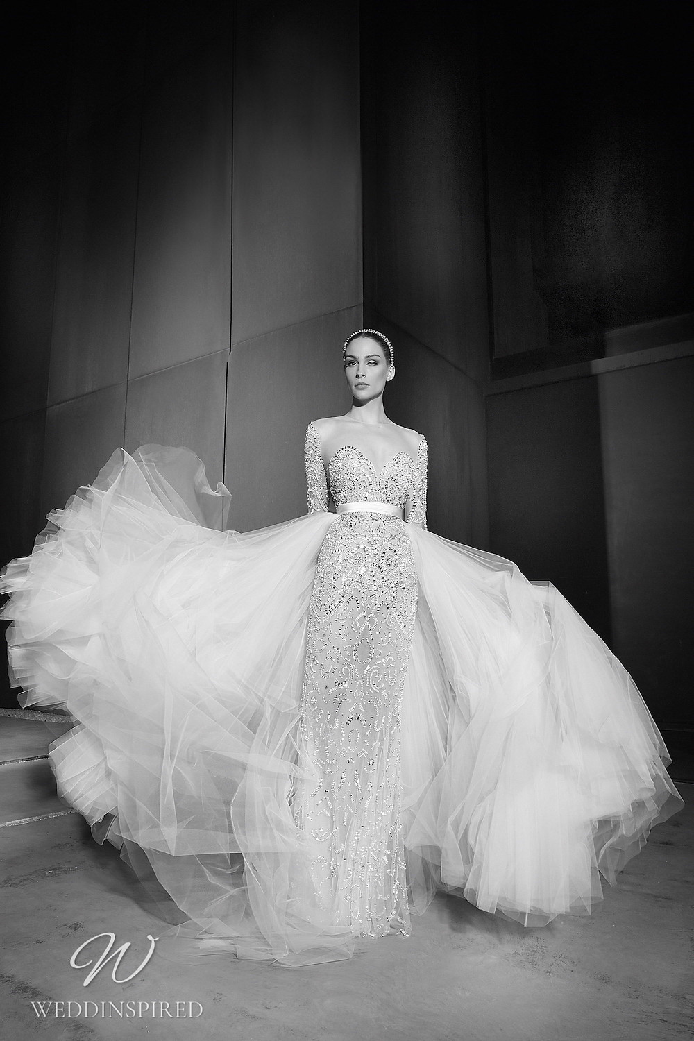 A Zuhair Murad Spring 2022 sparkly mesh mermaid wedding dress with long sleeves and a tulle detachable skirt