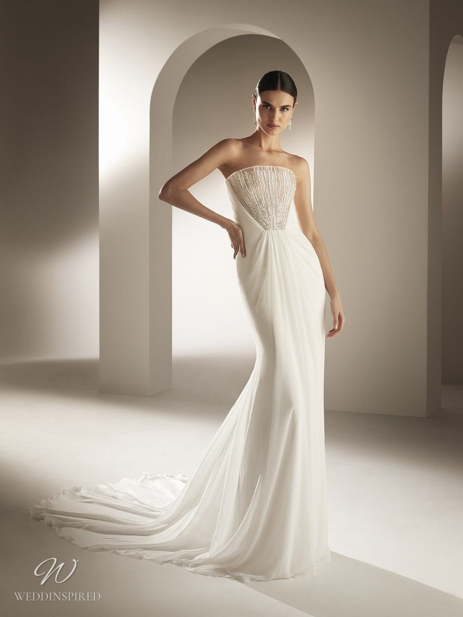 An Atelier Pronovias soft chiffon strapless A-line wedding dress with crystals and a train