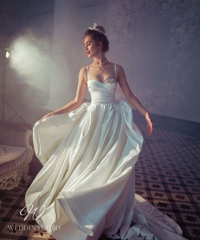 A Blammo-Biamo 2021 silk ball gown wedding dress with thin spaghetti straps and a sweetheart neckline