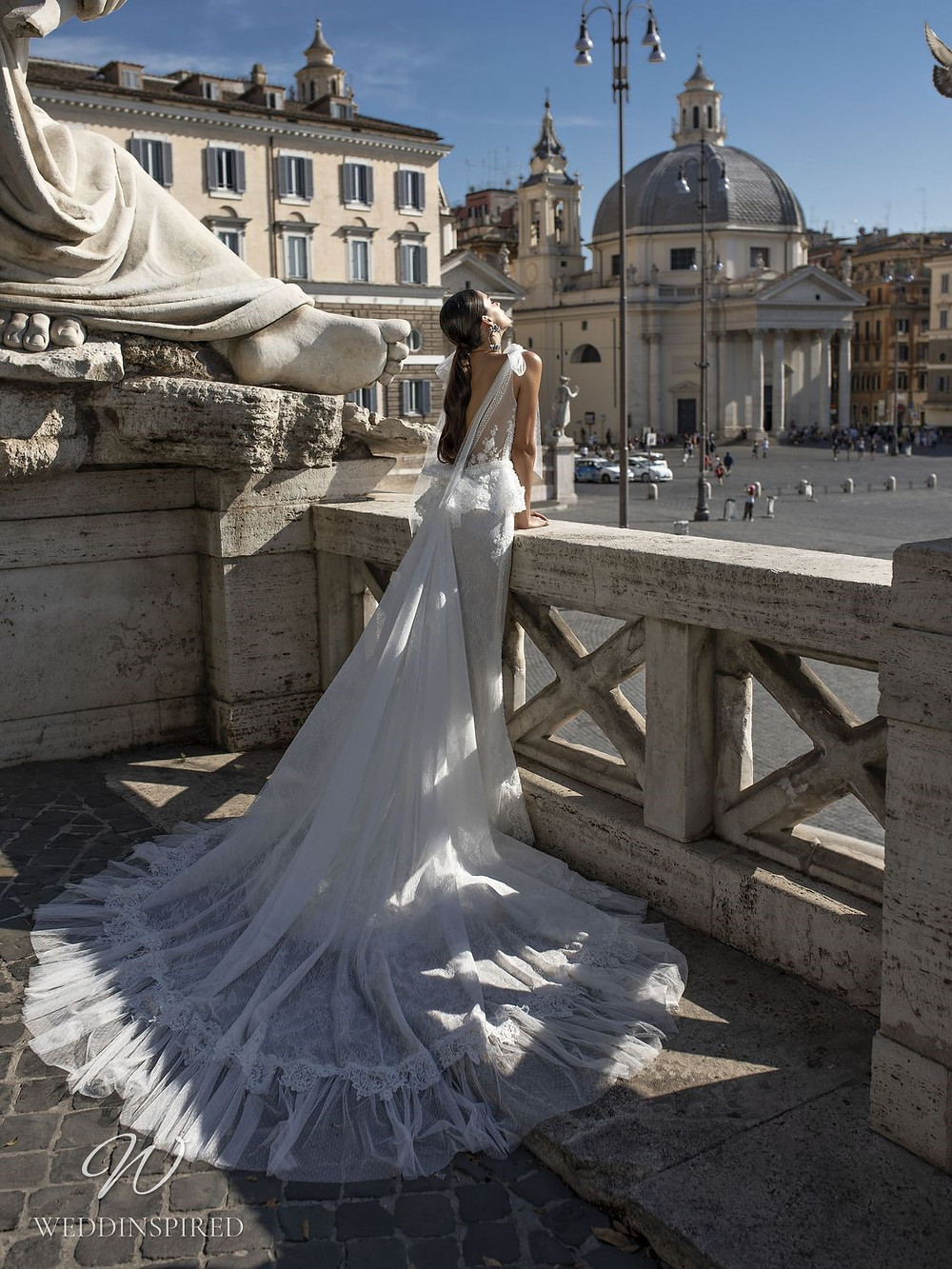 A Pinella Passaro lace mermaid wedding dress with a low back and a train