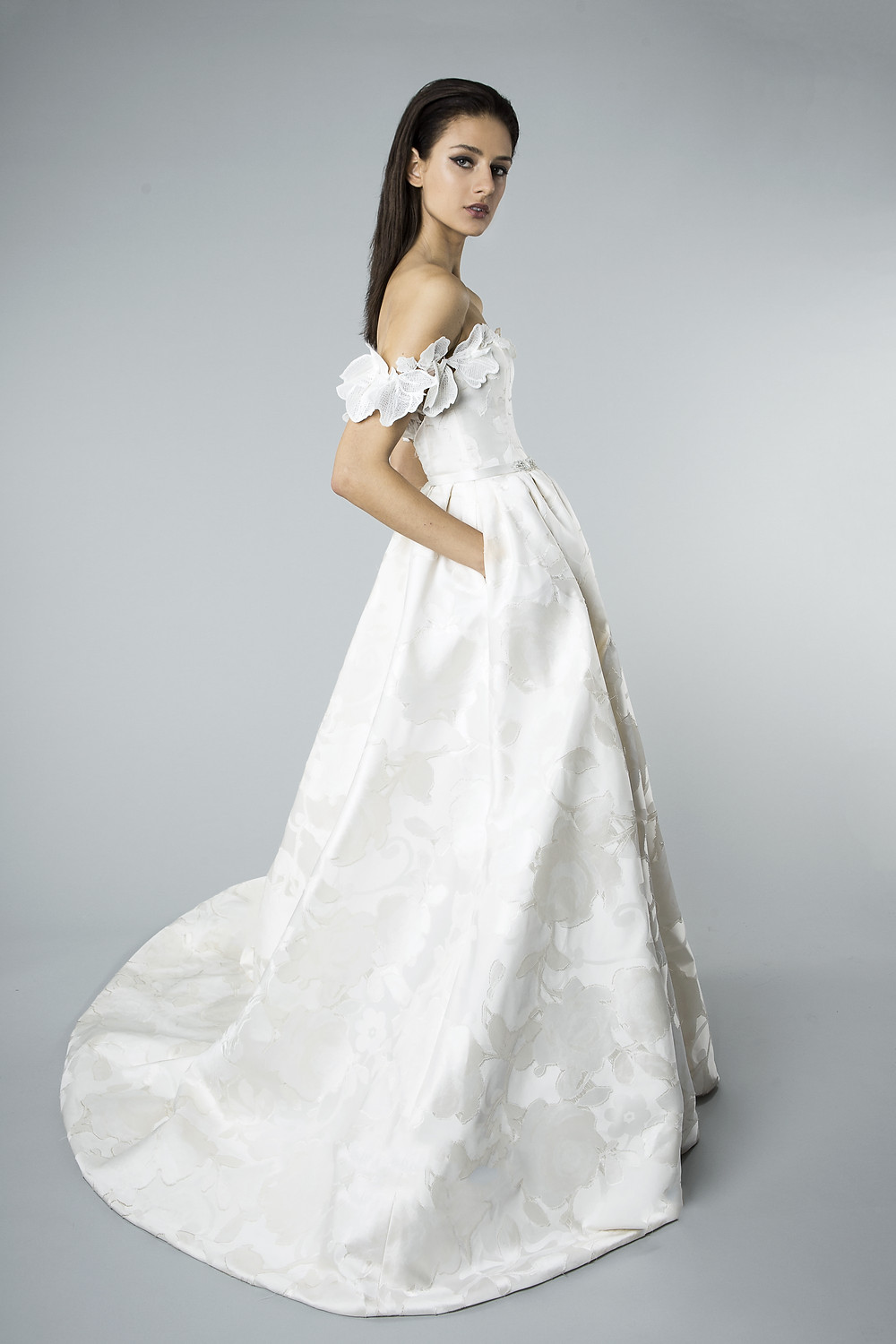 A Mira Zwillinger off the shoulder jacquard taffeta ball gown wedding dress with pockets