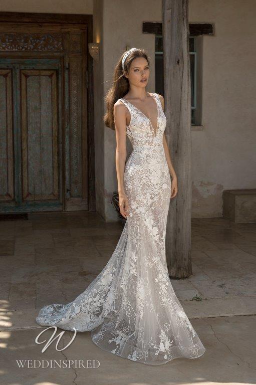 A David Hasbani lace mermaid wedding dress with a v neckline