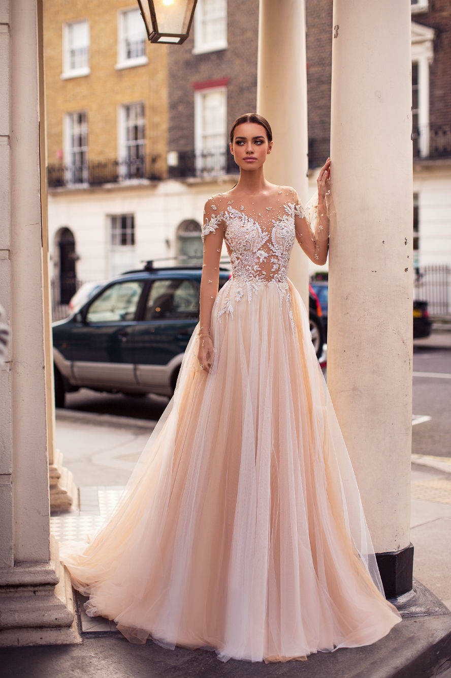 A Milla Nova blush lace and mesh ball gown wedding dress