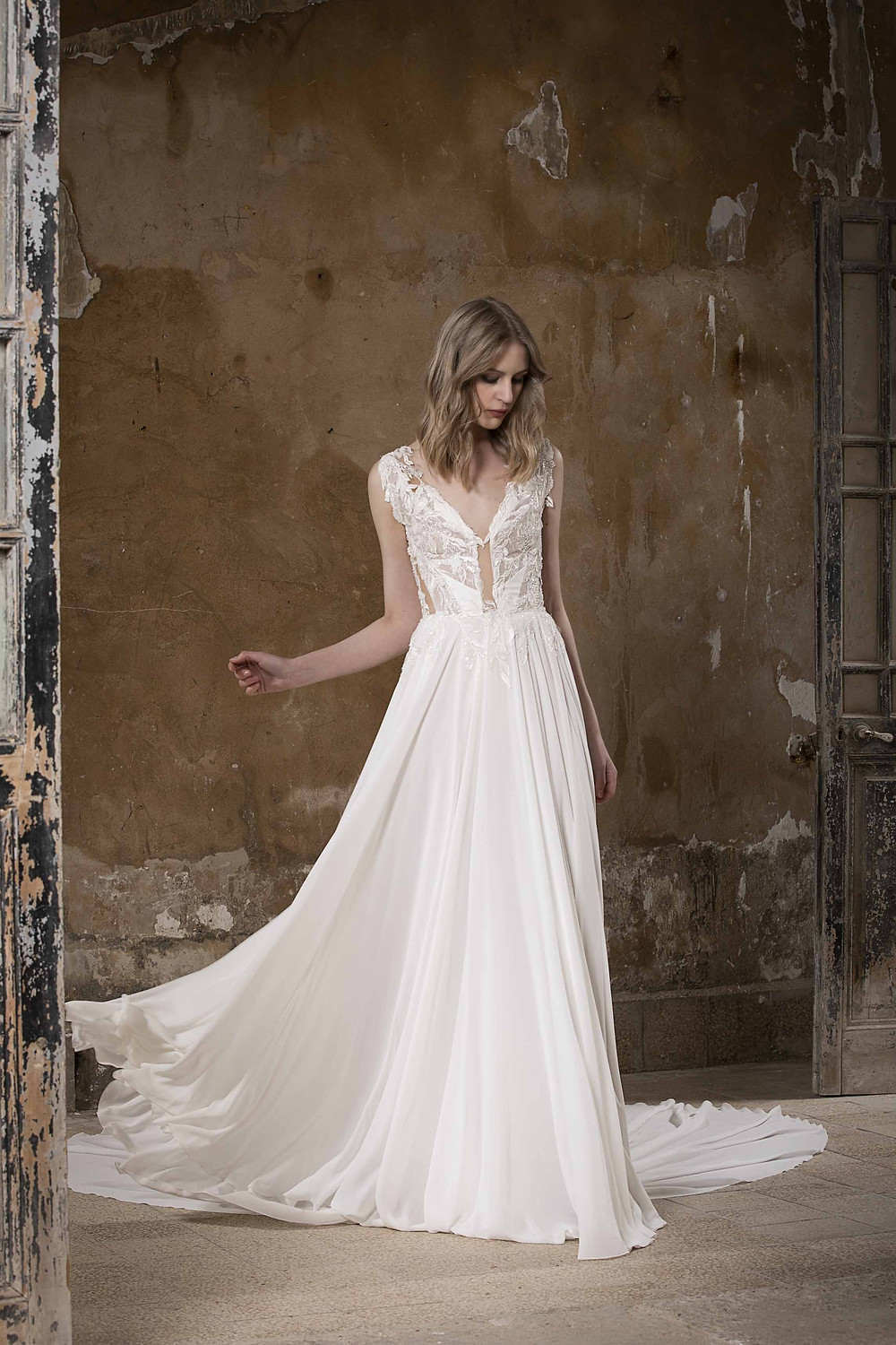 An A-line wedding gown enriched with delicate detailing and a soft flowy skirt