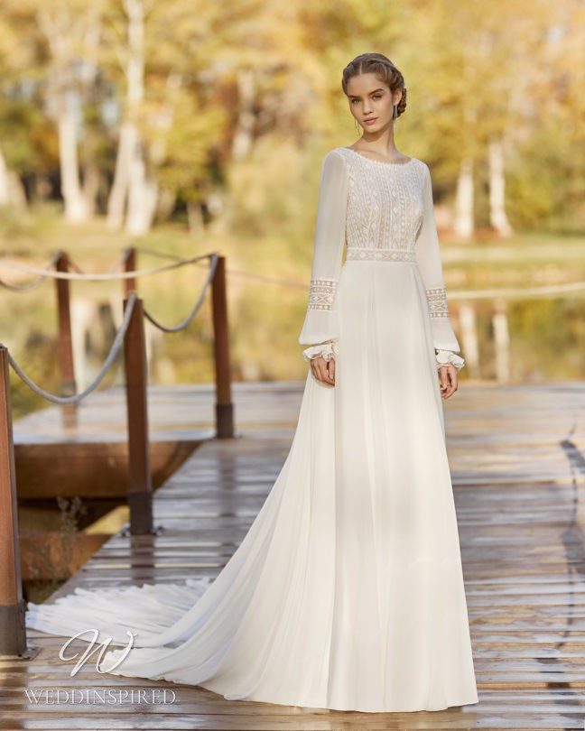 An Aire Barcelona 2021 modest flowy boho A-line wedding dress with long sleeves