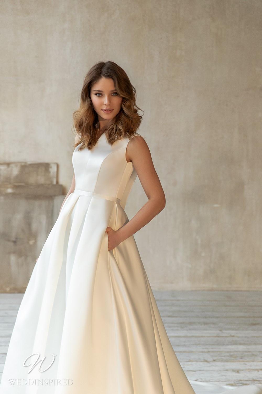 An Eva Lendel 2021 simple silk ball gown wedding dress with pockets